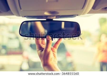 Hand adjusting rear view mirror. #364855160