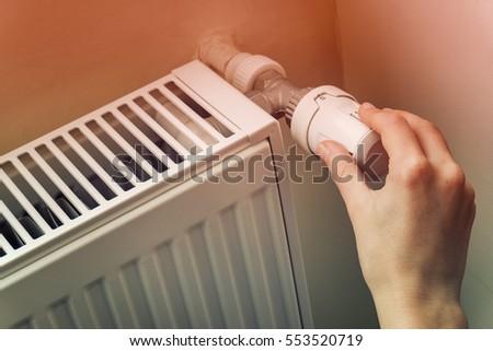 Shutterstock Hand Adjusting The Knob Of Heating Radiator