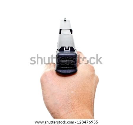 hand aiming a handgun on white background - stock photo