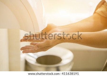 Hand Air Dryer In Public Toilet or Washrooms. selective focus, vintage color