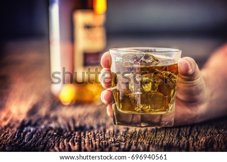 Hand alcoholic and drink the distillate whiskey brandy or cognac.