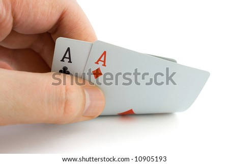 Hand and aces, isolated on white background