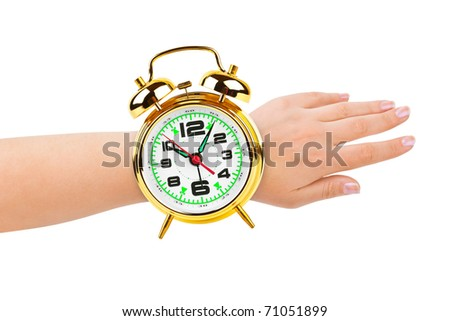 Hand and alarm clock like a watch isolated on white background