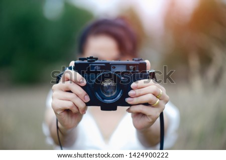 Hand and camera of the photographer Holding and carrying the camera to take pictures