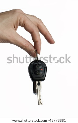 Hand and car key isolated