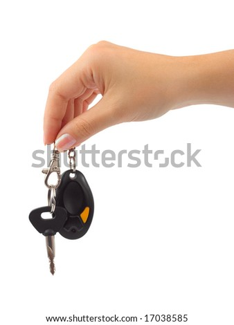 Hand and car key isolated on white background