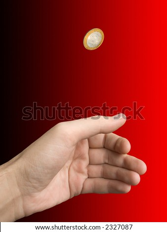 Hand and coin (choice) on blur (black-red) background