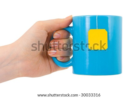 Hand and cup of tea isolated on white background