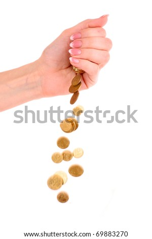 Hand and falling coins isolated on white background