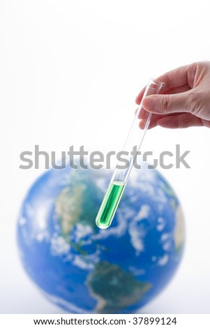 Hand and globe with test tube