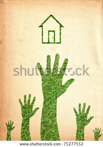 Hand and house.(Green energy concept)