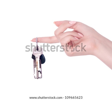 Hand and keys isolated on white background