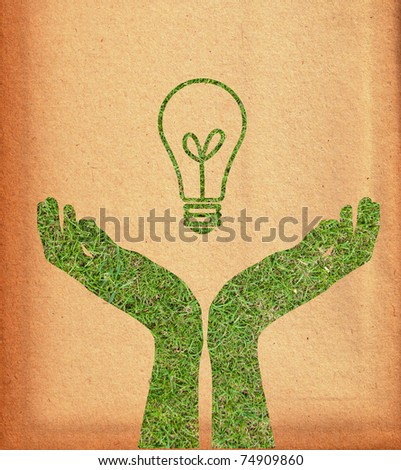 Hand and light bulb.(Green energy concept)