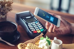 Hand and mobile payment in coffee shop ,mobile payment concept