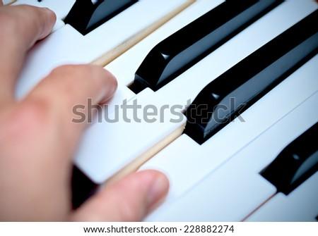 Hand and Piano Keys, Playing Piano