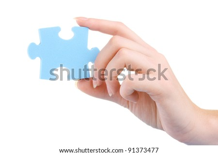 Hand and puzzle, isolated on white