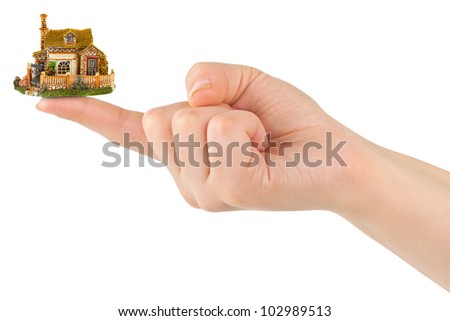 Hand and small house isolated on white background