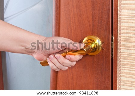 Hand and the door handle