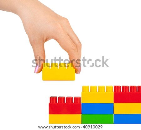 Hand and toy wall isolated on white background