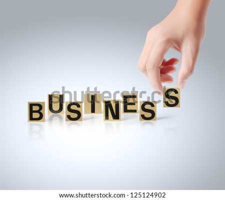 Hand and word Business on white background