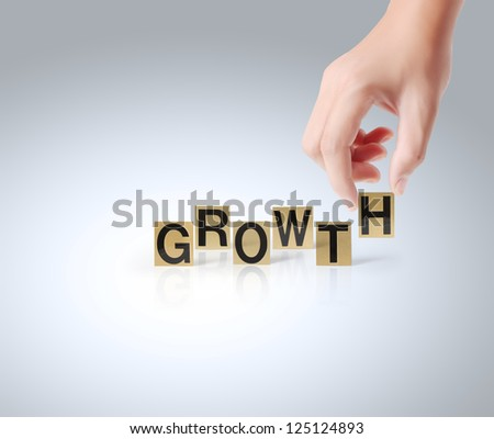 Hand and word growth on white background