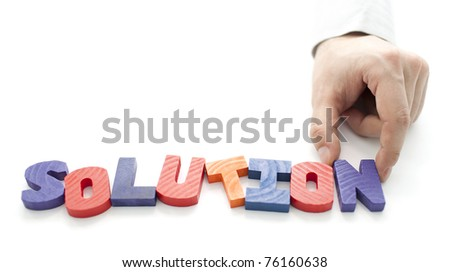Hand and word Solution on white background - stock photo