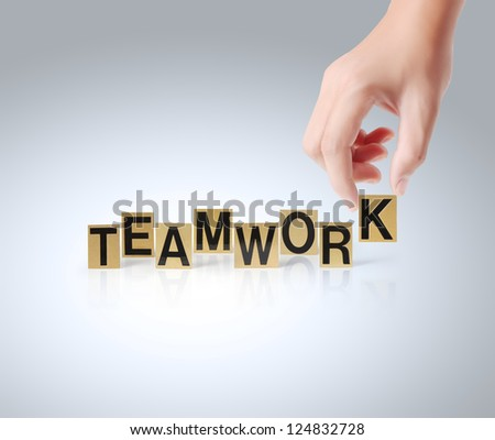 Hand and word Teamwork isolated on a white background