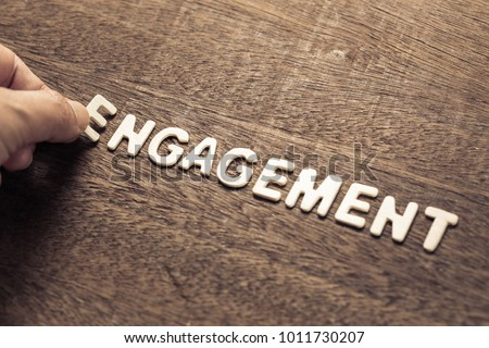 Hand arrange wood letters as Engagement word for marketing concept