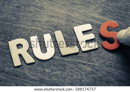 Hand arrange wood letters as Rules word - Shutterstock ID 588174737