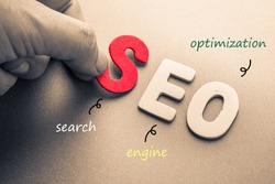 Hand arrange wood letters as SEO abbreviation (Search Engine Optimization)