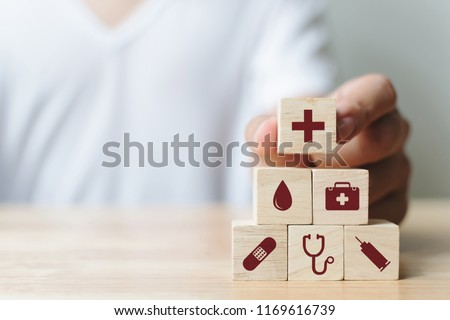 Hand arranging wood block stacking with icon healthcare medical, Insurance for your health concept #1169616739
