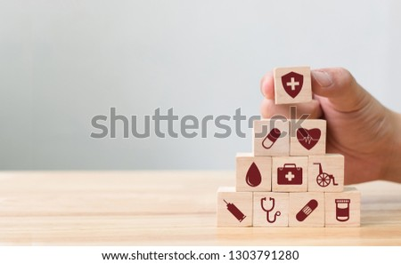 Hand arranging wood block stacking with icon healthcare medical, Insurance for your health concept #1303791280
