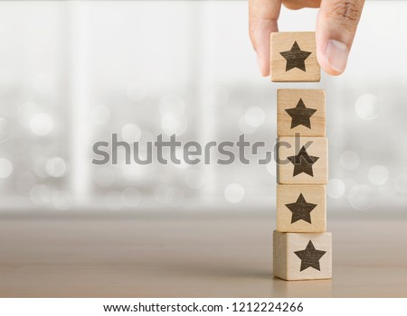 Hand arranging wooden blocks with the five star symbol. The best rating, the best ranking, the best service, goal, success concept. #1212224266