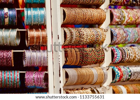 Hand Bangles arranged for sales in a Bangle shop #1133755631