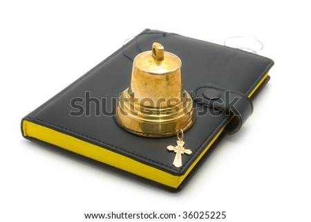 Hand-bell, dagger and the bible on a white background