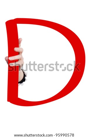 Hand breaking white paper surface holding letter 'D' from red alphabet set