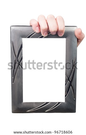 Hand breaking white paper surface holding metal frame