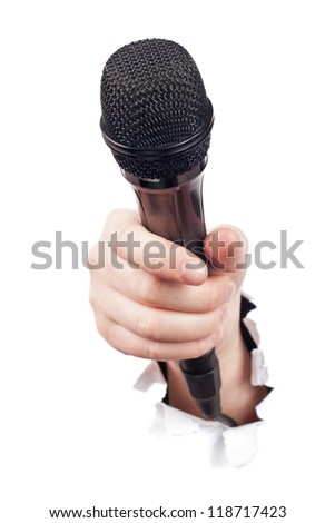 Hand breaking white paper surface holding microphone