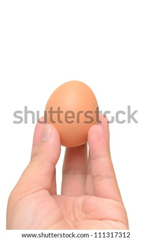 Hand bring Egg isolated on a white background