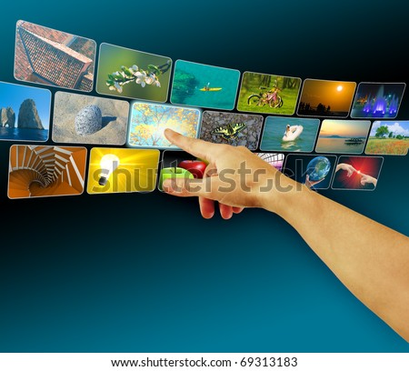 Hand browsing images in virtual space using touch screen interface, concept for e-commerce or cyberspace