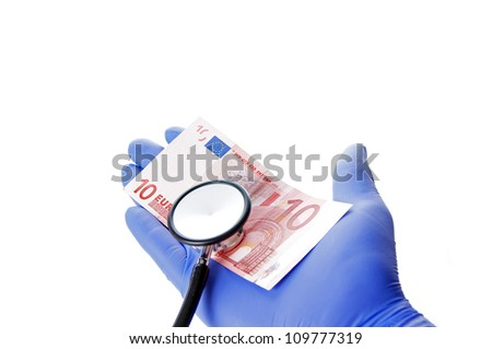 Hand by a doctor with stethoscope and ten euro / practice charge