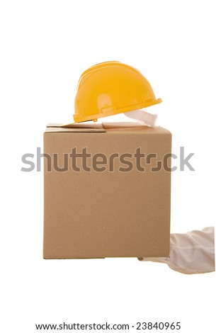 Hand carrying a cardboard box and a security helmet
