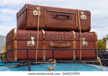 stock-photo-hand-carryon-on-the-roof-of-retro-car-tied-with-ropes-266021090.jpg