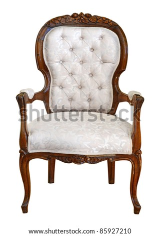 Hand carved antique arm chair with clipping path on white background