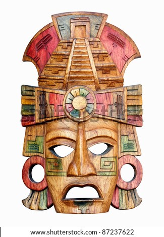 Hand carved wooden Mayan mask isolated on a white background
