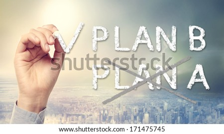 Hand checking PLAN B over the city skyline background