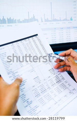 Hand checking the value from the paper and graph and number also shown on the screen.