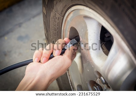 Hand checking tyre pressure