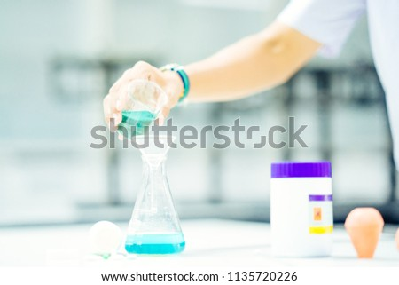 hand chemist pouring chemical...