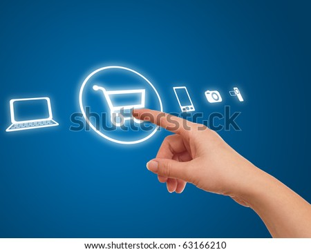 hand choosing shopping cart symbol from media icons on blue